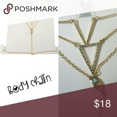 NIB Body chain Sexy NIB body chain, can be worn over or under clothing, perfect with a bikini or under a low cut, button down or v-neck top! Gold tone chevron detail Accessories