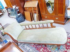 19TH CENTURY OAK FRAMED CHAISE LONGUE ON TURNED SUPPORTS Estimate: £80 - £120
