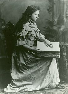 Helen Keller reading braille. She was born in Tuscumbia, AL.