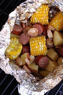 Ingredients 8-12 pieces of corn on the cob (4 full cobs cut in half or in thirds) 4 red potatoes, washed and cubed 20-30 uncooked shrimp (peeled or not, it's up to you) 1 Lb. smoked sausage, cut into chunks melted butter (or olive oil), to taste 1/2 c. chicken broth (you may not need that much) Cajun/Creole seasoning (we like to use Tony Chachere's brand), to taste salt and pepper, to taste