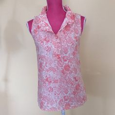 j.Crew sleeveless top Beautiful salmon and cream colored flowered J.Crew sleeveless top. Three button neckline. Soft ruffle around neck. Soft and silky. Fully lined. J. Crew Tops