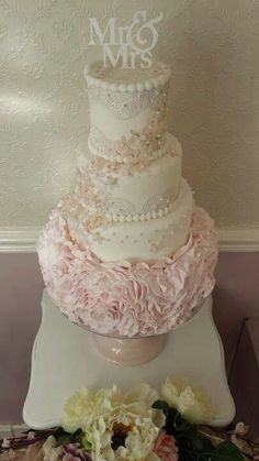 Pink ruffle wedding cake with flowing edible paper blossoms by Corr's Cakes