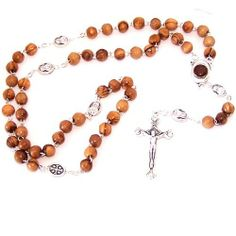 Olive wood beads Rosary made with Silver our Father beads and Soil Rosary Center from the Holy Land. Comes with gift Bag and Certificate Holylandmarket Rosaries. $42.50. Center has Holy Earth from Jerusalem area. Top quality olive wood Rosary. Ships from Jerusalem. Comes with an Organza bag and a certificate of Authenticity and a Lord's Prayer gift card. Made with Silver beads ( our Father beads ) that have Jerusalem Cross and Immaculate heart of Mary on the other side