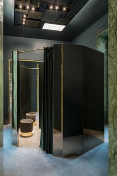 Luxury Boutique Lagrange12 in Turin by Dimore Studio | Yellowtrace.  Deep dark green, green marble retail interior, brass detailing