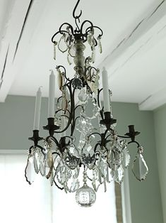 Love that antique chandelier from Modern Country Style blog: Summer Home Tour In Demark