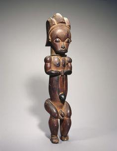 Master of Ntem. Reliquary Guardian Figure (Eyema-o-Byeri), 1750-1860. Wood, iron, 23 x 5 7/8 x 5 in. (58.4 x 14.9 x 12.7 cm). Brooklyn Museum