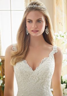Embroidered Lace Appliques on Tulle with Wide Scalloped Hemline Wedding Dress Designed by Madeline Gardner. Colors: White, Ivory, Ivory/Light Gold
