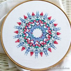 An embroidered kaleidoscope: even more fun than adult coloring books! :-)