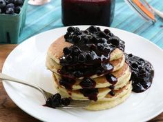Get Fluffy Lemon Ricotta Pancakes with Blueberry Sauce Recipe from Food Network