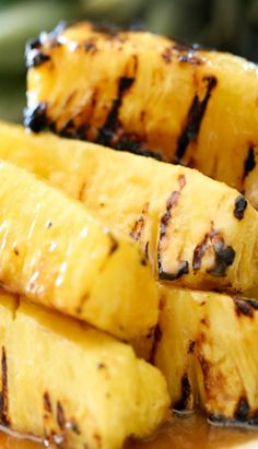 COCONUT BROWN SUGAR GLAZED GRILLED PINEAPPLE  ==  ingredients ==  1 Pineapple, trimmed and cut into wedges ½ c butter, melted ¾ c brown sugar, packed 2 T Honey 1 t imitation coconut extract ===========