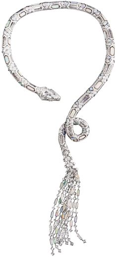 Boucheron Serpent diamond, opal and rock crystal necklace.    Via The Jewellery Editor.