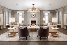 Classy neutral living room with a lovely symmetry. Nice open feel with lots of light and flowing curtains. Laura Hammet design.