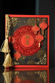handmade card: Happy Chinese New Year by kitty1wu ... red and black with gold embossing ... tassles ... coin design in background ... gorgeous ...
