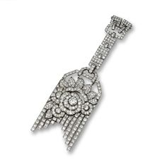 DIAMOND TASSEL PENDANT, CIRCA 1925 Designed as an openwork floral plaque supporting articulated fringes on a square-link surmount,set in the center with an old European-cut diamond weighing approximately 1.45 carats, further decorated with 355 round and old European-cut diamonds weighing approximately 22.50 carats, mounted in platinum