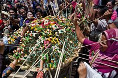 Javanese people jostle for the 'Gunungan', a sacrifice in the shape of a mountain, during the Grebeg ritual as part of celebrations for Eid ...