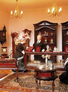 The jeweler in the largest miniature department store in the world. Miniature Dollhouse Furniture, Vintage Dollhouse, Miniature Houses, Dollhouse Dolls, Miniature Dolls, Dollhouse Miniatures, Putz Houses, Doll Houses, Doll Museum