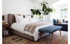 Tread Gender-Neutral Territory -- When crafting a space that both men and women feel at home in, neutrals and woods are your best friends. A headboard that emphasizes shape rather than color is a great way to avoid a look that feels too basic, and a classic rug, such as an Oushak, is something everyone can agree on. Bedside tables, a bench, or chairs in streamlined wood add a tactile quality. Get more interior design inspiration and master bedroom styling ideas on the One Kings Lane Style…