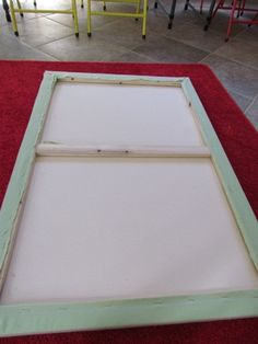 How to make a flannel board from mounted canvas.    Finished back side of the flannel board