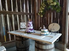 two whiskey barrels white door signs and big wreath