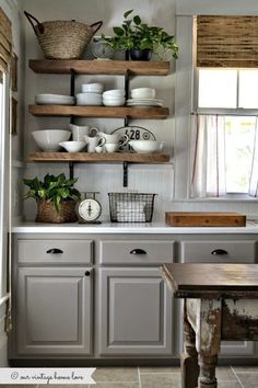 Those shelves are great! Also like the worn island table