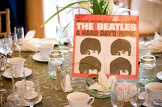 Album cover centerpieces. Can use a picture of the album cover on the place cards.