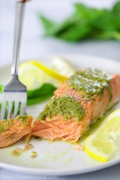 Baked salmon fillets with fresh pesto butter on top. A quick salmon dinner done in 15 minutes from start to finish. Baked salmon fillets with fresh pesto butter on top. A quick salmon dinner done in 15 minutes from start to finish. Pesto Salmon Baked, Baked Salmon Recipes, Fish Recipes, Seafood Recipes, Cooking Recipes, Healthy Recipes, Salmon Pesto Pasta, Cake Recipes, Recipies