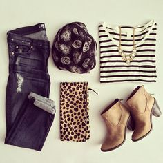 Mixing prints and patterns: Jeans, striped top, skull scarf, leopard clutch, brown ankle boots, gold jewelry