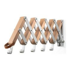 Pear-Wood Collapsible Garment Hanger - For those tight-fitting spaces, this collapsible garment rack is a perfect temporary fix. German engi...