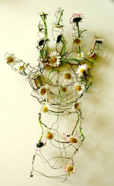Helen Butler. Untitled. Wire sculpture with Daisies.    http://www.flickr.com/photos/abcdefghelen/
