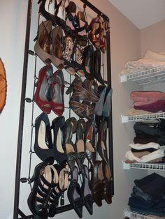 My repurposed crib spring to hanging shoe rack.