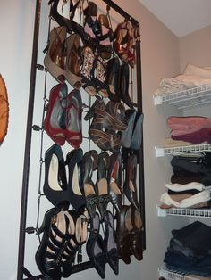 My repurposed crib spring to hanging shoe rack.