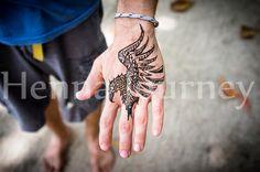 Henna hawk tribal design on guy's hand Geometrical simple bird for men