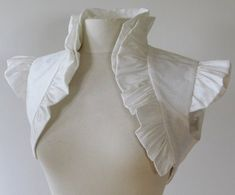 Ruffled white bolero. I really want to make one for a steampunk dress or for regular wear. I'm slightly obsessed with these at the moment.