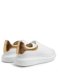 Alexander McQueen Raised-sole low-top leather trainers Gold Leather, Leather Heels, Metallic Gold Heels, Mcqueen Sneakers, Gold Logo, Calves, Alexander Mcqueen, Lace Up