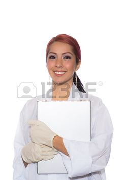 Young woman wearing a lab coat while holding a clipboard and standing Stock Photo
