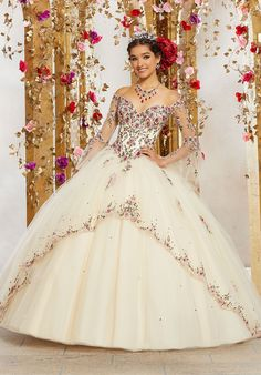 Valentina Quinceanera 34003 Crystal Beaded Embroidery on a Tulle Ball Gown with Embroidered Edged Skirt Overlay and Bell Sleeves. Quince Dresses, 15 Dresses, Gowns With Sleeves, Bell Sleeves, Mori Lee Prom, Diana, Pretty Quinceanera Dresses, Quinceanera Ideas, Champagne Quinceanera Dresses