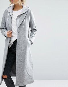 Longline grey coat paired with hoodie sweatshirt and boyfriens jeans