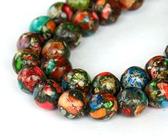 Hey, I found this really awesome Etsy listing at https://www.etsy.com/listing/217476851/multicolor-impression-stone-beads-8mm