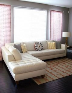 For the family room. Cream leather sectional- Simple, fresh, and kid friendly.