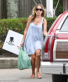 Casual but a catch: Sarah Jessica Parker donned a light blue, baby doll dress as she picked up groceries for her and husband Matthew Broderick at The Hamptons on Thursday