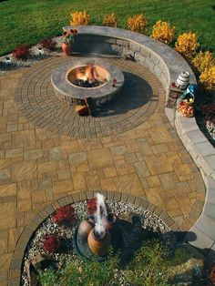 Stamped Concrete Patio, Firepit, band and Seating Wall!