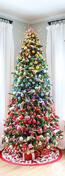 A Colorful Christmas Tree Idea! I like this and think it's pretty but would not decorate our tree like this. A Colorful Christmas Tree Idea! I like this and think it's pretty but would not decorate our tree like this. Rainbow Christmas Tree, Beautiful Christmas Trees, Noel Christmas, All Things Christmas, Christmas Crafts, Christmas Ideas, Elegant Christmas, Outdoor Christmas, Whimsical Christmas