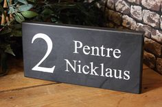 Another Welsh slate house sign handcrafted by us for a customer. You really cannot beat the quality and look of a Welsh slate as a finishing touch to your home.  Design and order yours today at www.valleymill.co.uk/personalised/house-signs/