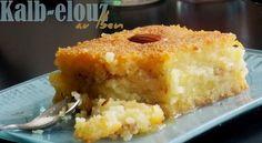 Kalb elouz au lben Je dirais que c'est The kalb elouz au lben une recette que je tenais à tester l'an dernier mas que j'ai enfin fini par réaliser avant le ramadan 2015 pour un petit essai :). Kalb elouz ou comme on l'appelle à l'ouest algérien Chamia et un gâteau semoule au coeur d'amande ...