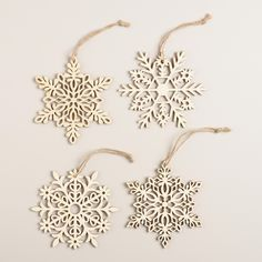 Our handcrafted ornament set features four laser-cut wood snowflakes that bring rustic style to your tree.