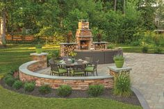 Large curved patio in woodland setting has a bordering seat wall and a fireplace with wood boxes. Large round table seats six and is set for lunch with a bright flower centerpiece. Backyard Retreat, Backyard Playground, Diy Pergola, Pergola Ideas, Pavers Ideas, Pergola Kits, Retractable Pergola, Modern Pergola, Pergola Roof