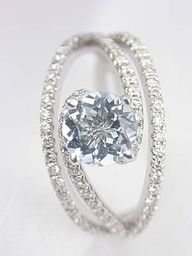 I normally prefer princess cut, but this is beautiful.  I love an unique looking ring.