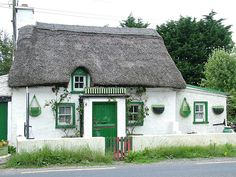 Cottages of Ireland The traditional Irish Cottage, was for generations the post card image of Ireland, the thatched roof, the homely turf Irish Cottage, Cute Cottage, Cottage Style, Petits Cottages, Storybook Cottage, Cabins And Cottages, Log Cabins, Country Cottages, Thatched Roof