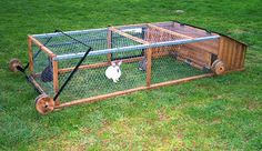 Rabbit/Chicken tractor.  Wheels bend towards the back to lift and push the tractor forward.