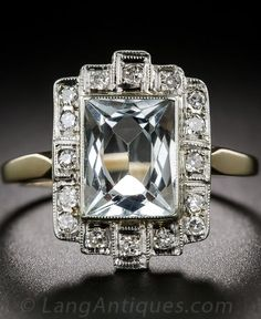 Art Deco Aquamarine and Diamond Ring. A rectangular placid pastel blue aquamarine, with an unusual scissor-cut faceting arrangement, is framed in diamonds with quintessential geometric Art Deco flair in this striking, original vintage just-for-fun ring, circa 1930, rendered in two-tone gold. The top of this beautiful bauble measures 3/4 by 3/8 inch.